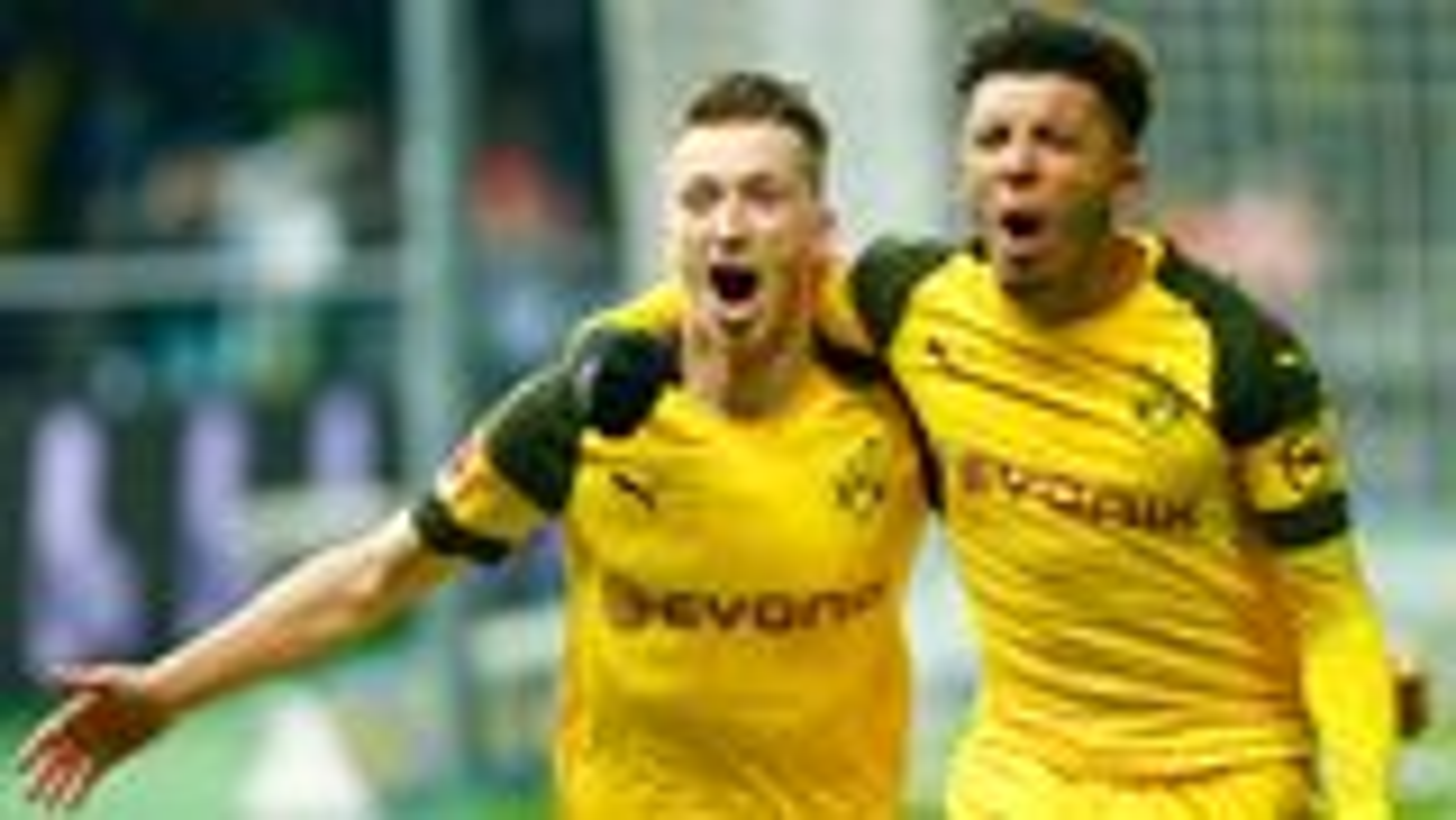 Dortmund stay level with Bayern after Reus stuns Hertha