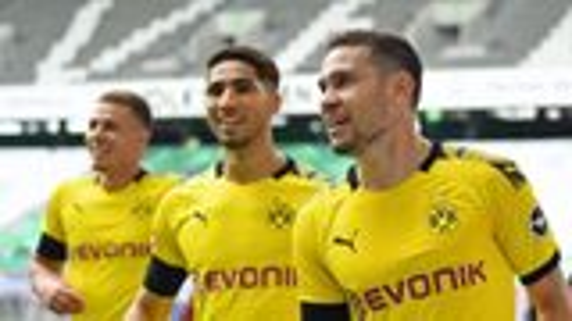 Dortmund keep pressure on Bayern with Wolfsburg win