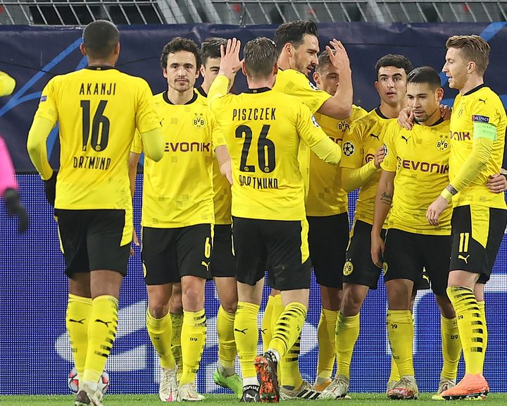 Raphael Guerreiro's first-half goal against Lazio was enough for Borussia Dortmund to secure their place in the knockout stage of the UEFA Champions League.